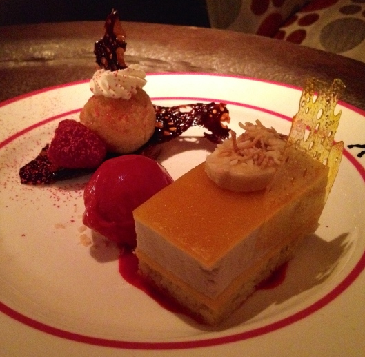 Dessert -- passion fruit layer cake, raspberry sorbet, liqueur-soaked cake with chocolate mousse underneath.